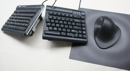 Handshoe Mouse to the right of a Freestyle Keyboard (with V3 attachment)
