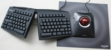 Slimblade Trackball Mouse to the right of a Goldtouch Keyboard